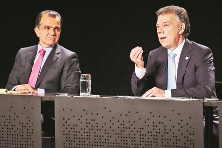Escandalos-y-paz-centran-debate-de-los-candidatos