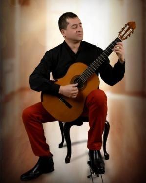 Andres-Segovia,-Ejecutando-su-insigne-composicion-musical